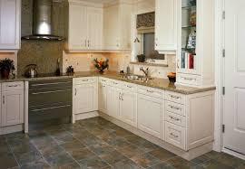 white kitchen cabinets with vinyl plank flooring 5 best kitchen flooring options for a renovation bob vila