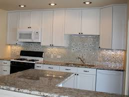 khaki glass tile kitchen backsplash with white cabinets u0026