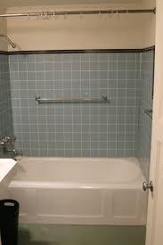 brown bathroom floating vanity with stainless steel sink and