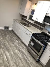 can i put cabinets on vinyl plank flooring home decorators stony oak grey vinyl plank flooring white