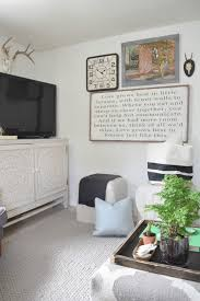 family room with wallpaper and chalkboard wall nesting with grace