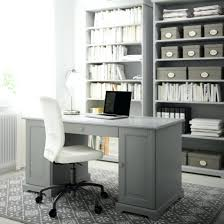 office design a home office with a grey desk bookcases and a