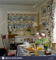 blue white china collection on cream dresser in cottage dining