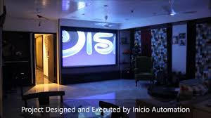 home theatre in living room projector and tv home automation