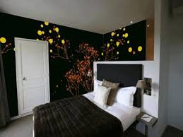 master bedrooms design black and white bedframe golden lamp with