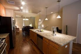 what color kitchen cabinets go with hardwood floors should you use hardwood floors in kitchens and bathrooms