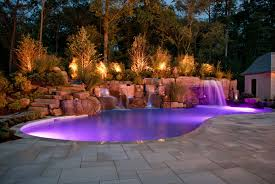 backyard outdoor lighting for natural swimming pool waterfall with