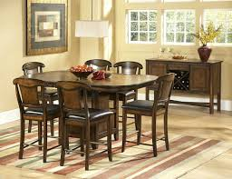 counter height dining table with swivel chairs storage base dark