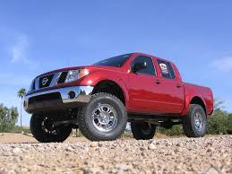 lifted silver nissan frontier nissan frontier suspension lift rancho rs6592 suspension system