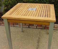 grade a teak tables from classicteak com
