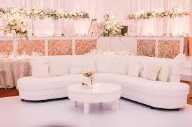 reception décor photos white sofa with soft pink throw pillows