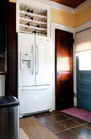 how to trim cabinet above refrigerator ideas for using that awkward space above the fridge