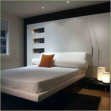 Simple Bedroom Decorating Ideas Tropical Bedroom Idea In Hawaii With White Walls Dark Hardwood