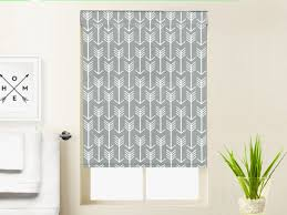 custom blackout roller shade window treatment in grey arrow