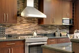 witching brown mosaic glass tile kitchen backsplash features black