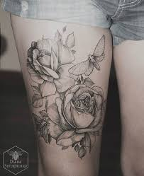 collection of 25 beautiful flower thigh tattoos for