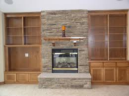stacked stone fireplace with built ins open wooden built in