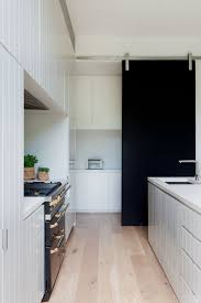 pics of modern kitchens 10 examples of barn doors in contemporary kitchens bedrooms and
