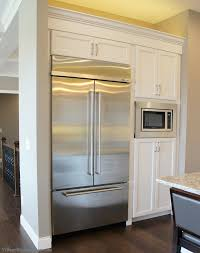 village home stores white painted kitchen with koch cabinetry and built kitchenaid refrigerator design