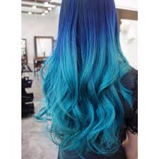 an ocean inspired hair color design featuring rich shades of