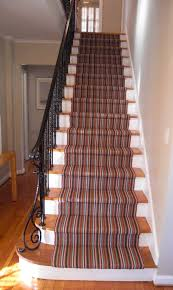Hall And Stairs Ideas by Interior Striped Stair Runner On Wooden Stairs With Black Iron