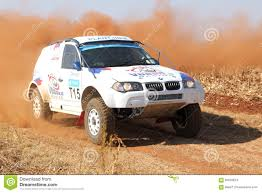bmw rally car drifting white bmw rally car kicking up dust on turn editorial