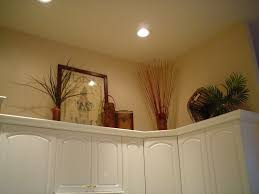 Above Cabinet Lighting by Decorate Above Kitchen Cabinets L Shaped Black Wooden Wall Cabinet