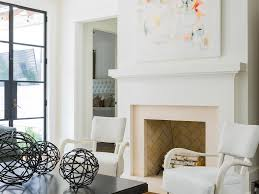 art above fireplace dark wood coffee table white beams chair