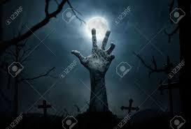 halloween concept zombie hand rising out from the soil stock