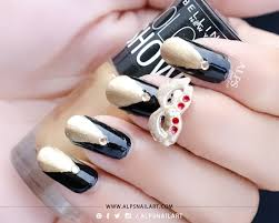 black and gold nails with triangle nail design inspired by