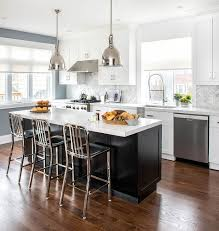 black wainscot kitchen island with chrome counter stools