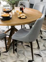 furniture modern round walnut dining table with gray chairs ans