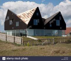 sunshine shining on metal roof of modern house the dune house on