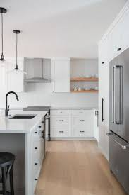 black kitchen cabinets with black hardware from show home to style and flow rue light wood floors