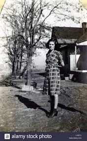 portrait of woman in dress on farm in the mid 1940s wwii era