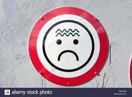 unhappy not happy face frown frowning circle sign stock photo