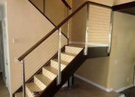 comfortable contemporary stair railing on interior with oak