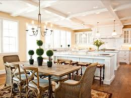 u shaped kitchen w two islands pendants over inner island dining