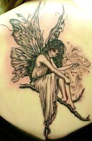 immerse yourself into a world of magic with fairy tattoo designs
