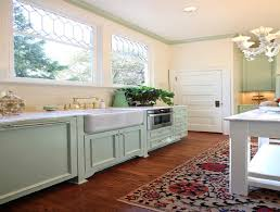 shabby chic kitchen design pastel green kitchen cabinet with floral rug for charming shabby