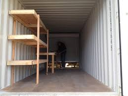 custom shelving and workbench in conex container simple box
