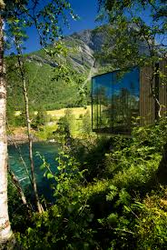 exterior view of glass wall of ex machina style house juvet hotel