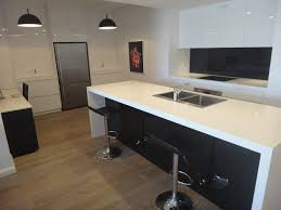 white kitchen cabinets with black island within white kitchen