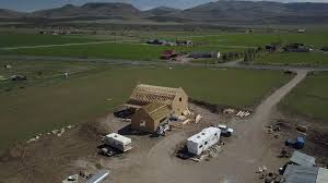 aerial carpenters working new rural house construction 4k 990