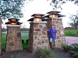 three of thirteen lanterns at an entrance to a subdivision post