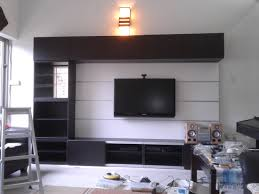 white walls home decor black tv on the white wall combined with black wooden panel plus