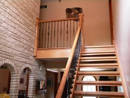 interior modern curved wooden staircase including stainless