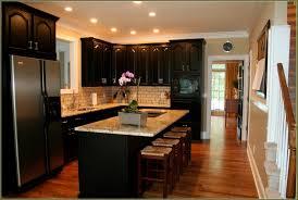 kitchen white galley kitchen with black appliances front door