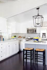 white shaker kitchen cabinets to ceiling a white sloped ceiling stands a white shaker kitchen