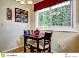 Flower Dining Table Dining Table With Flower Pot In Bright Kitchen Room Stock Photo